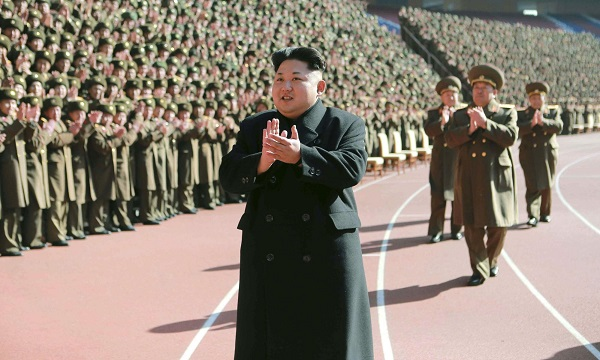KCNA photo shows North Korean leader Kim clapping during a photo session with the participants of a meeting of military and political cadres