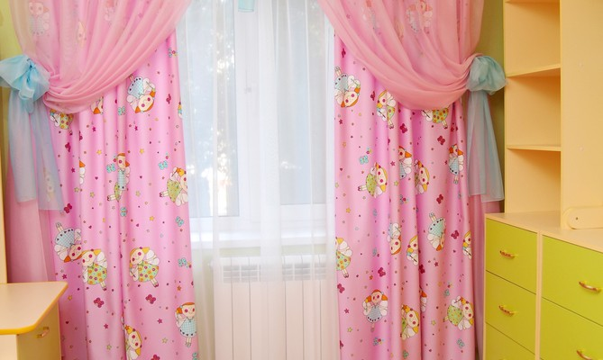 Pink curtains in a nursery